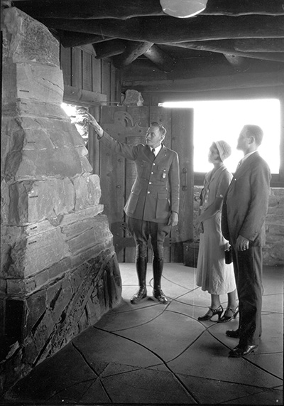 Ralph Reburn shows visitors the geological column