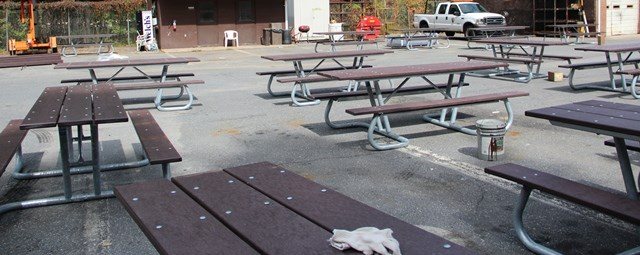 a pictures of fifteen tables that were assembled by volunteers