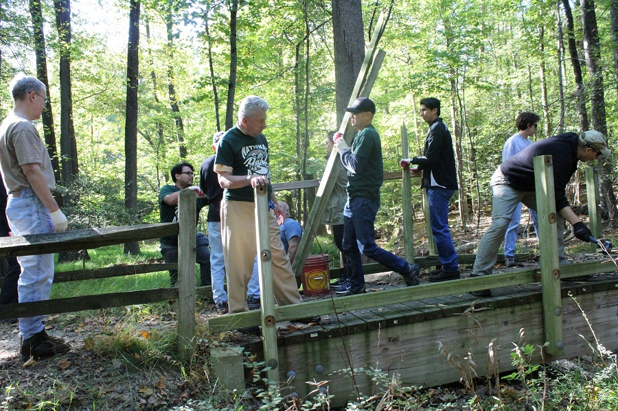 volunteers repairing a bridge in Greenbelt Park, Maryland