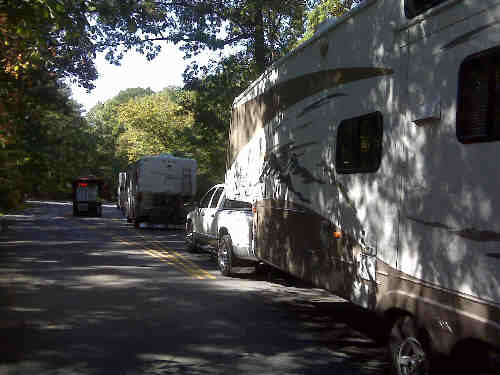 a picture of RV's arriving at the Campground fee booth