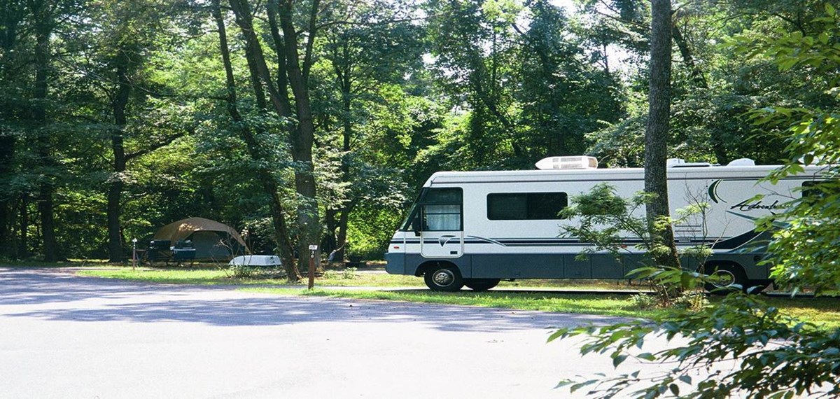 a picture of a RV and a tent in the Greenbelt Park campground