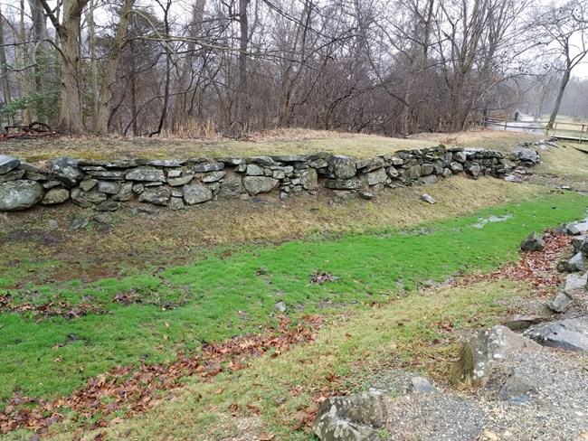 Here is an image of the stone ruins of an upstream portion of the Potomac Canal at Great Falls Park VA without water in it. This would be what visitors normally see when the visit the canal ruins here.