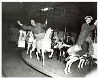 Riders on the Dentzel carousel