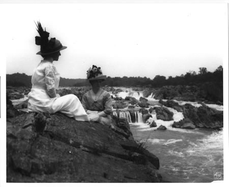 Two women view the falls in the 1920s.