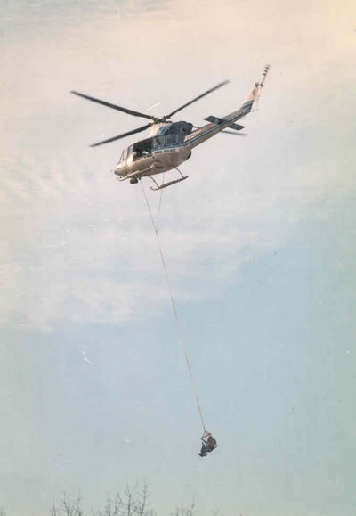A person being rescued by the U.S. Park Police helicopter