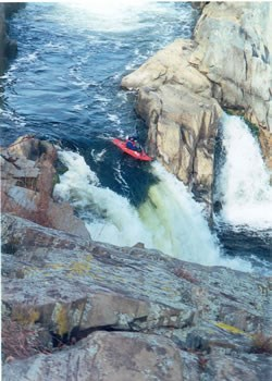 Kayaker running the falls