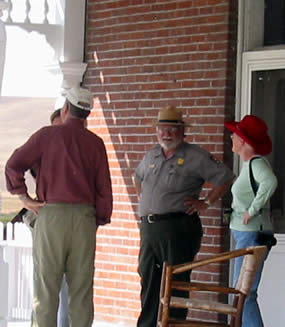 Park ranger answering visitor questions.