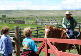 Ranger giving a cowboy talk for visitors.