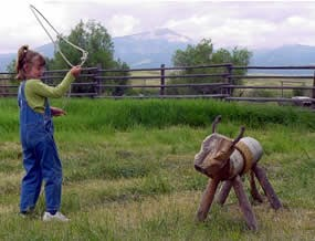 Taking to time to practice roping Woody the wooden steer.