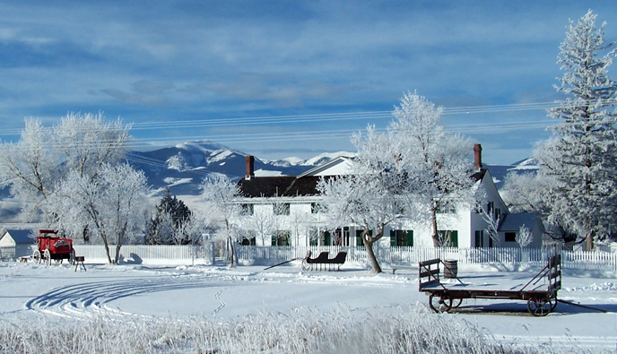 Winter view of the main ranch house and Mount Powell.