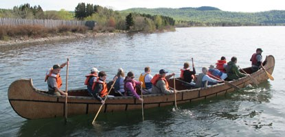 Staff paddle a 40' Montreal Canoe on Lake Superior.