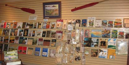 Slat wall and tables display books, toys, crafts and clothing; all sales items in the Eastern National Heritage Center bookstore at Grand Portage