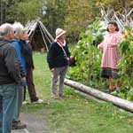 Visitors talk with historic gardeners at the Three Sisters Garden.