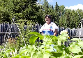 The historic gardener at Grand Portage enjoys tending garden vegetable varieties in the kitchen gardens.