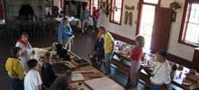 Visitors talk with an interpreter inside the Great Hall.