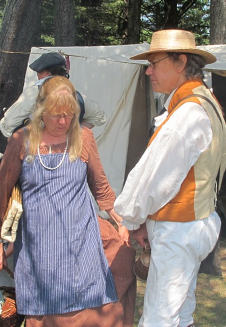 Re-enactor in period dress enjoying Rendezvous Days.