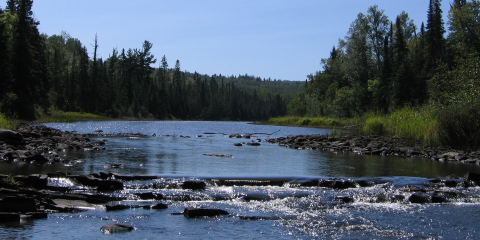 Pigeon River flowing over rock area.