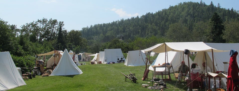 Canvas tents cover the grass in the Historic Encampment.