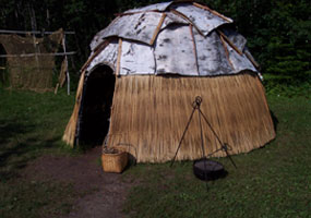 A summer lodge in the Monument's Ojibwe Village.