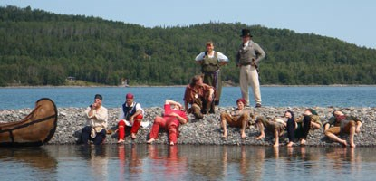 Voyageurs rest on spit of Grand Portage Island.