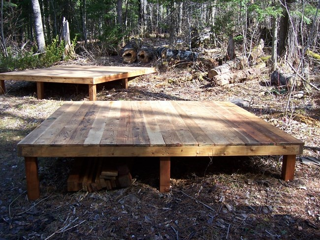 Wooden decks at Fort Charlotte campgrounds for tents.