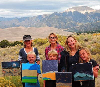 Paula Jo Miller Abstract Art Workshop Participants pose with Paintings