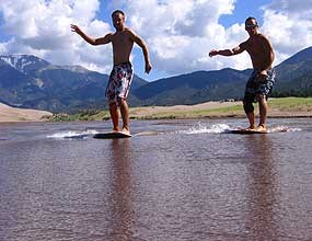 Skimboarders on Medano Creek