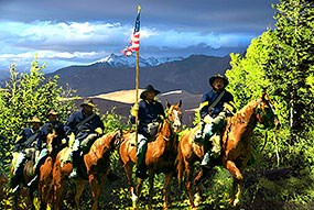Black Buffalo Soldiers on Horseback with Dunes in Background