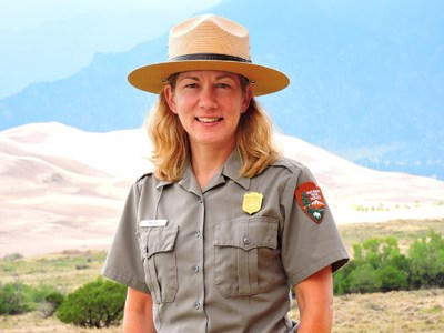 Superintendent Pam Rice with Dunes and Mountains in Background