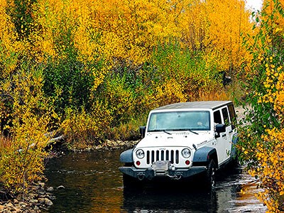 Jeep Crossing Medano Creek with Gold Aspens
