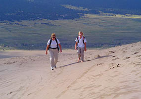 hikers on the dunes