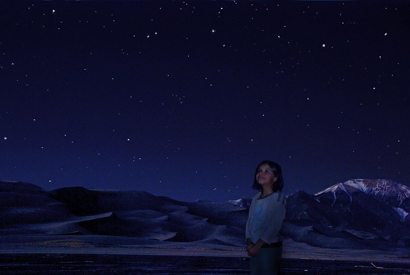 Girl Gazing at Night Sky at Base of Dunes
