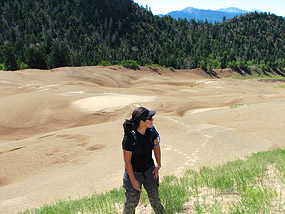 Woman Hiking Dunes near Forest