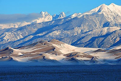 Snowy dunes and mountains