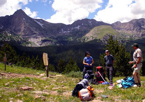 Backpackers get advice from a ranger at Music Pass, Great Sand Dunes National Preserve