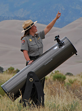 Ranger with telescope doing night sky program