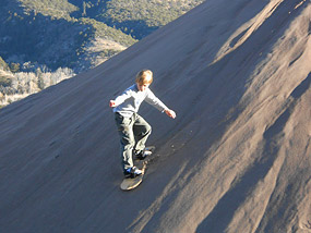 Boy Sandboarding at Great Sand Dunes