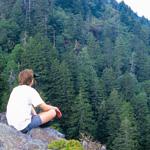 Hiker relaxing at overlook. Ken Voorhis photo.