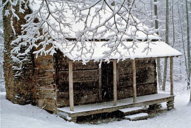 Snow blankets the John Ownby cabin during a winter storm.