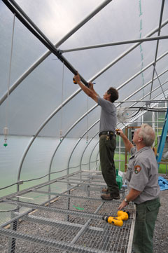 Maintenance crews work on the new greenhouse.
