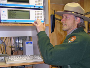 Jim Renfro inside the Look Rock monitoring station.