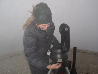 Kate sets up night sky monitoring equipment.