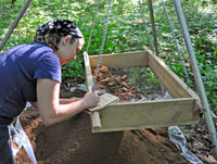 Melissa Crisp labels an artifact at a Cataloochee excavation.