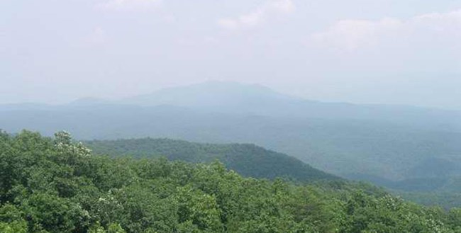 View from the Look Rock Tower showing the mountains obscured by haze.