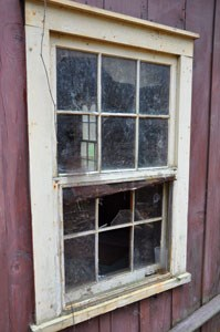 A broken window sheds light on cabins at Elkmont.