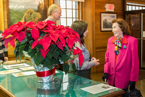 Rangers welcome Wanneta Johnson who donates a poinsettia every year on the anniversary of her son's rescue.