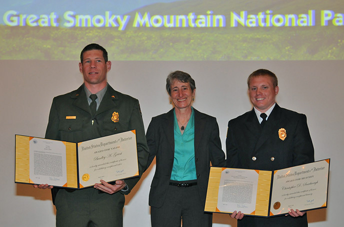 Ranger Griest, Interior Secretary Sally Jewel, and Firefighter Scarbrough pose with their awards.