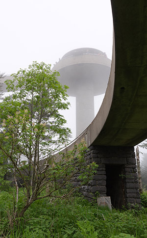 A view of the observation tower in the fog, taken from the base of the tower.
