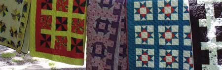 Colorful quilts displayed at Cosby in the Park.