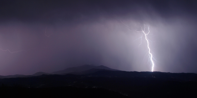 View from Look Rock Tower -- A lightning bolt hits the mountains on the western edge of the park.